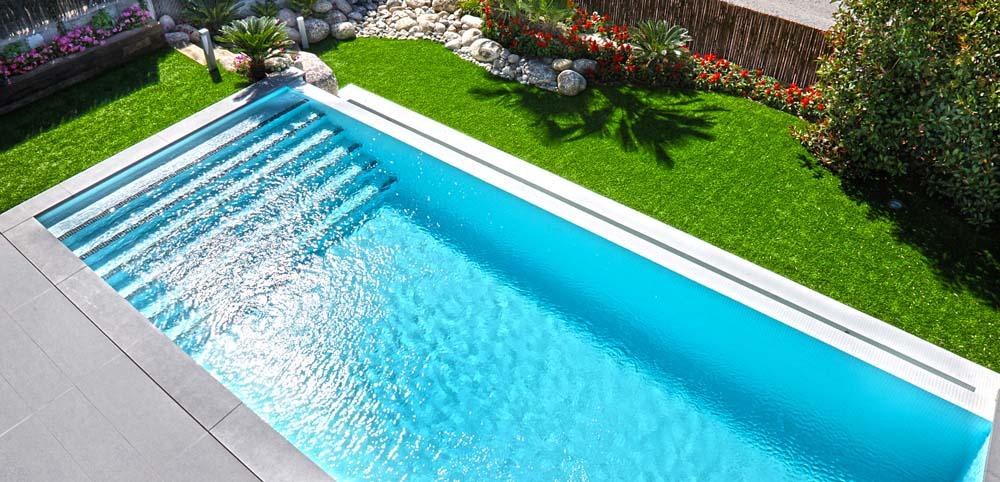 Galer a piscinas de obra piscina plus for Modelos piscinas de obra